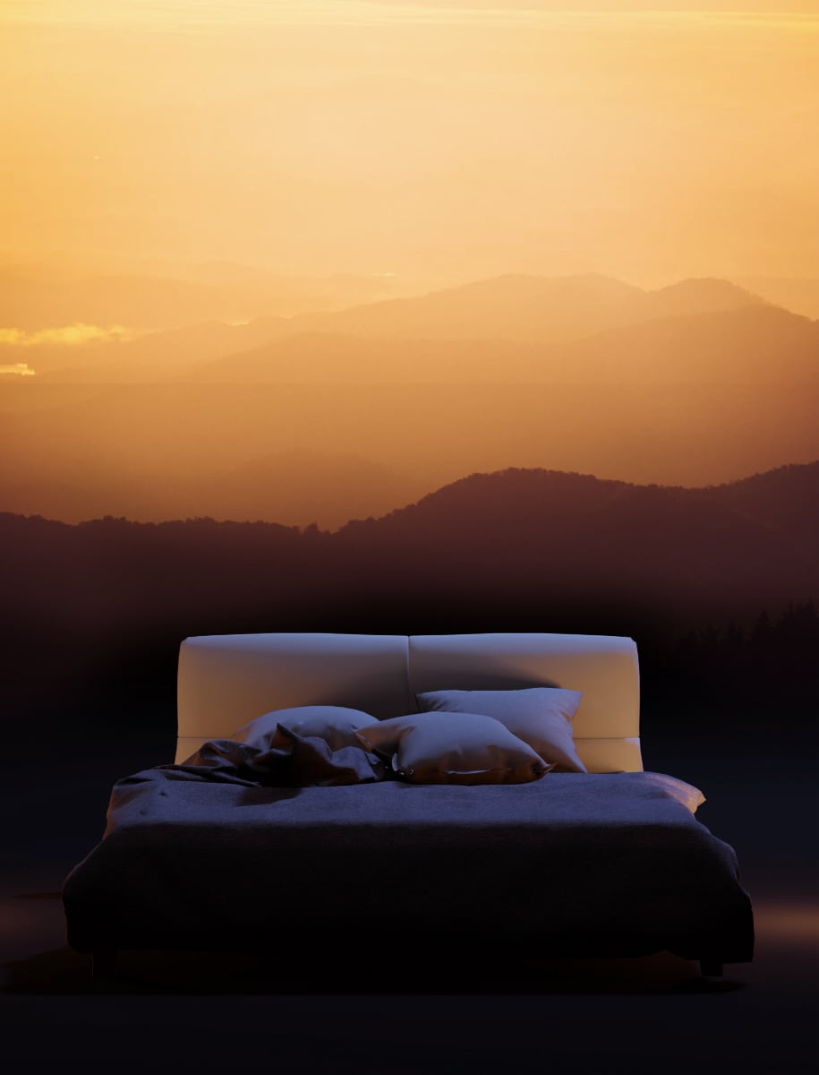 Photo of a bed at sunrise